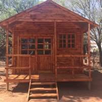 Log Cabin with veranda and Sliding Door on Stilted Base